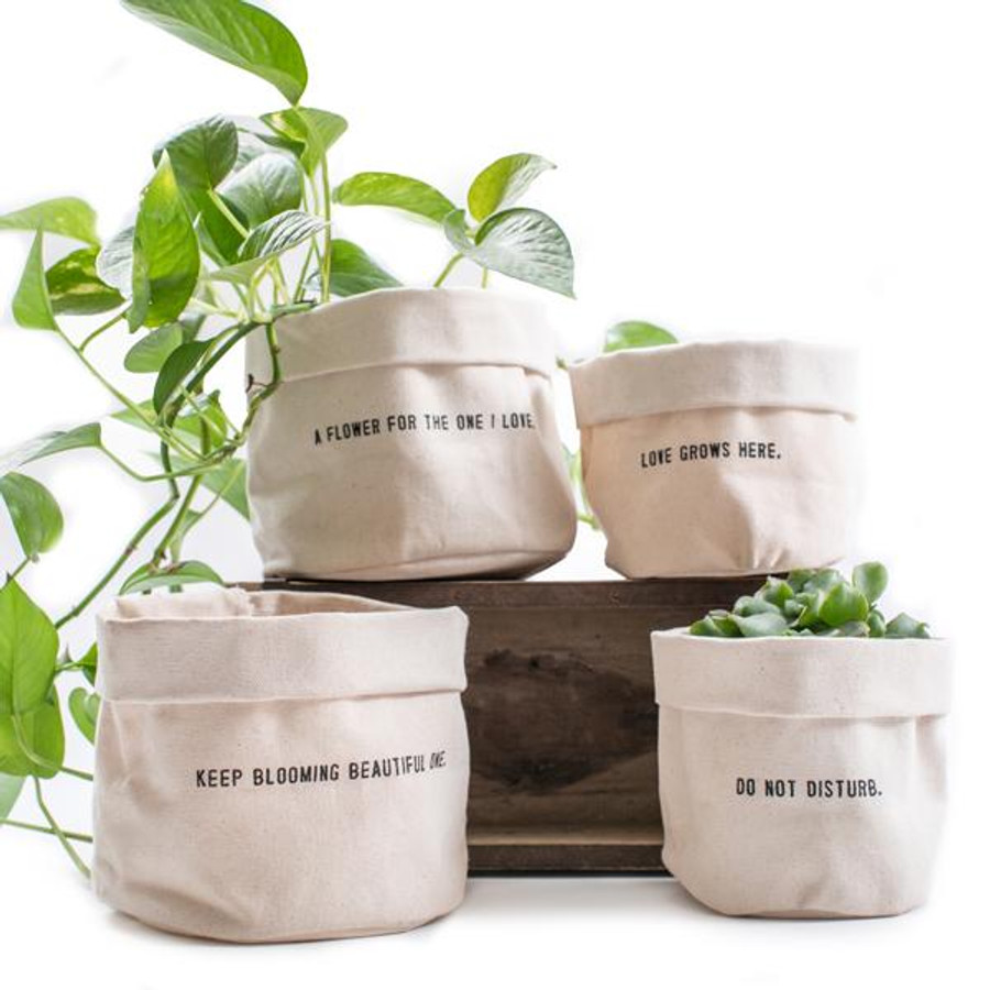 canvas planters with plants sitting on top of a wood brick mold