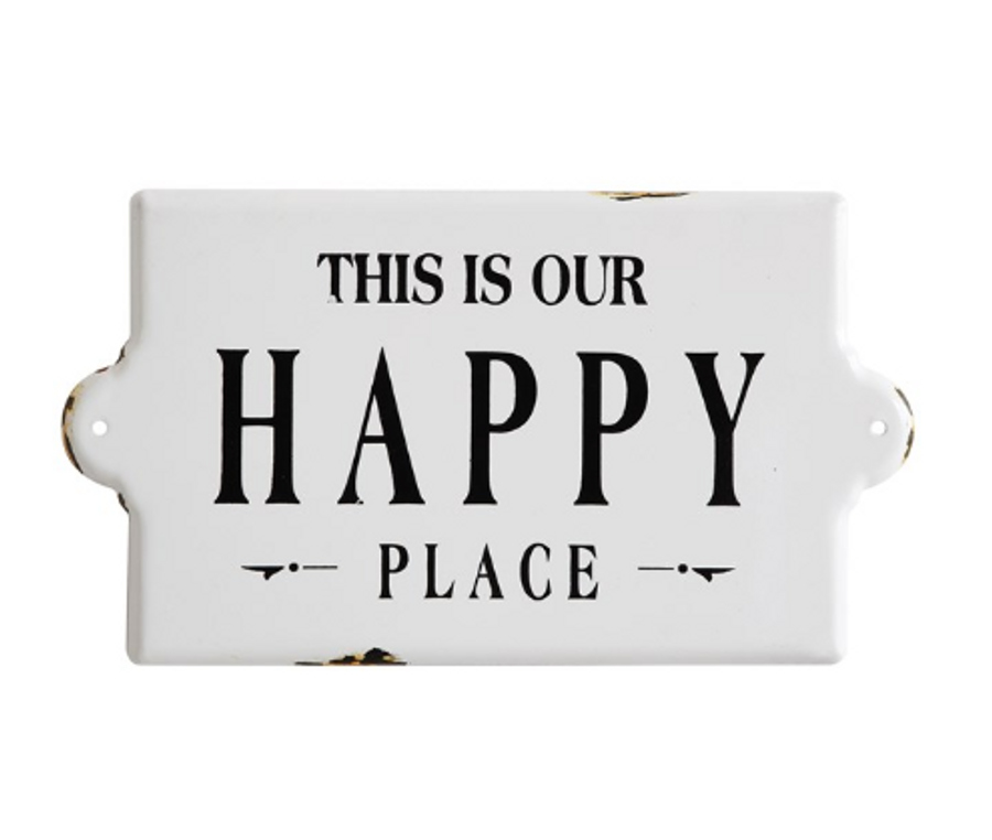 white ceramic wall sign with black writing