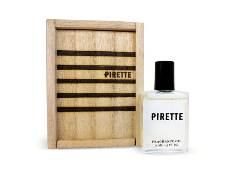 wooden box and bottle of perfume