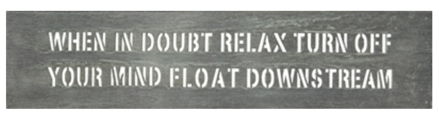 "metal decorative sign that reads ""when in doubt relax turn off your mind and float downstream"""