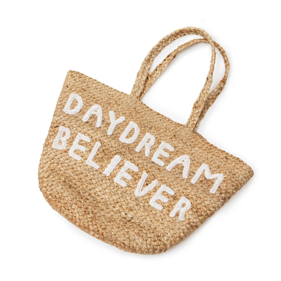 """jute tote bag with two handles and white embroidery reading """"daydream believer"""""""