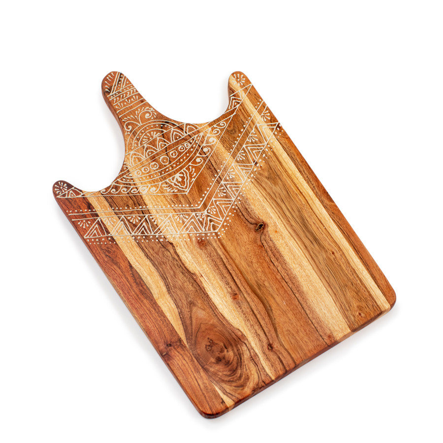 wood cutting board with hand painted mandala art around the handle