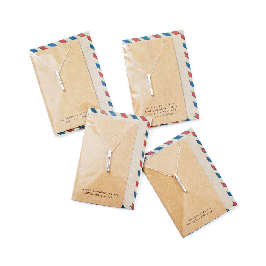 4 envelopes each containing a bar necklace