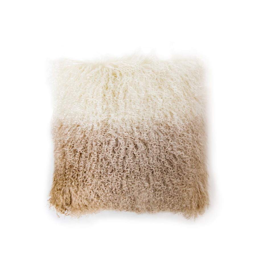 a square tibetan fur pillow that starts with ivory and fades to a dark cream almost light brown color
