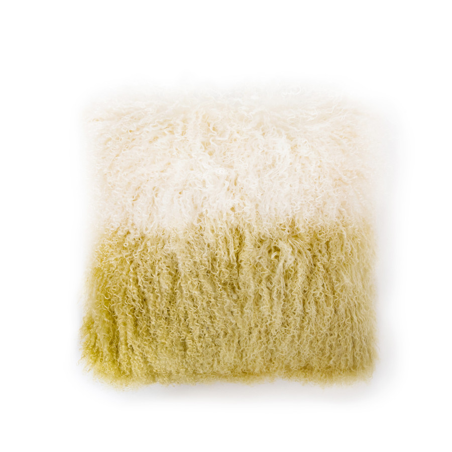 a square tibetan fur pillow with ivory fur that fades to a mustard colored yellow