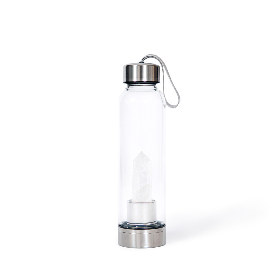 clear glass water bottle with a white quartz crystal at the bottom. Bottle has a metal bottom and top that can be removed.