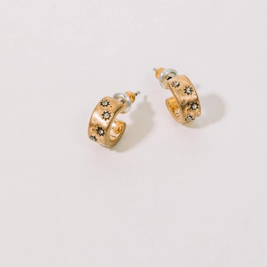 small half hoop earrings with tiny stars and gems embossed.