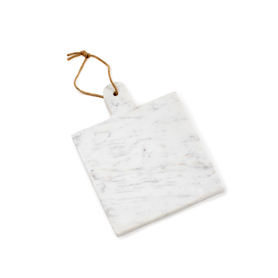 A square marble cutting board/ platter with a leather strand threaded through the handle.