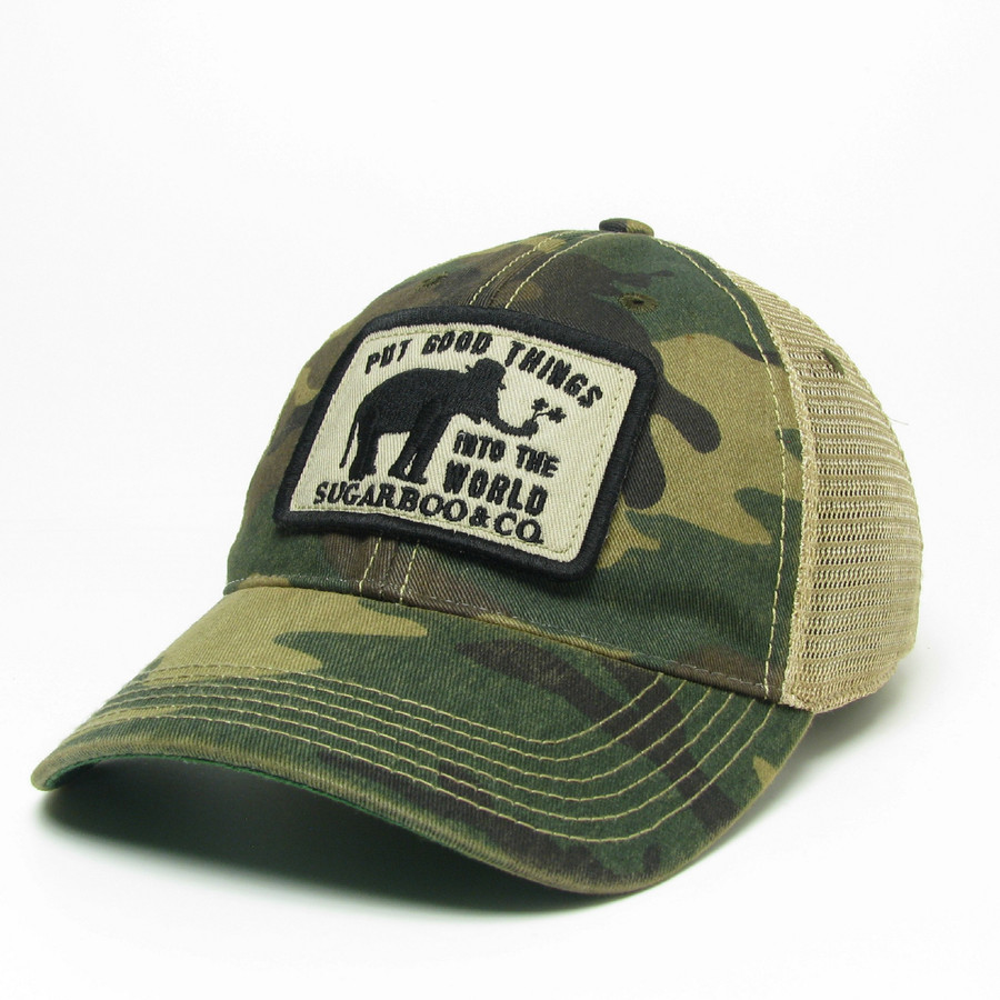 "army green camo design with a black and white patch reading ""go out and put good things into the world"""