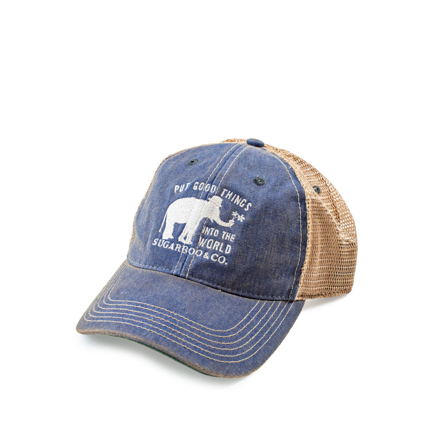 """blue and cream trucker styled hat with a white embroidered elephant the Sugarboo motto """"put good things into the world"""""""