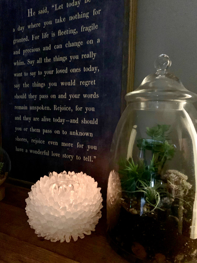 clear quartz vase with a charcoal Jackson Kiddard art print and a terrarium with succulents