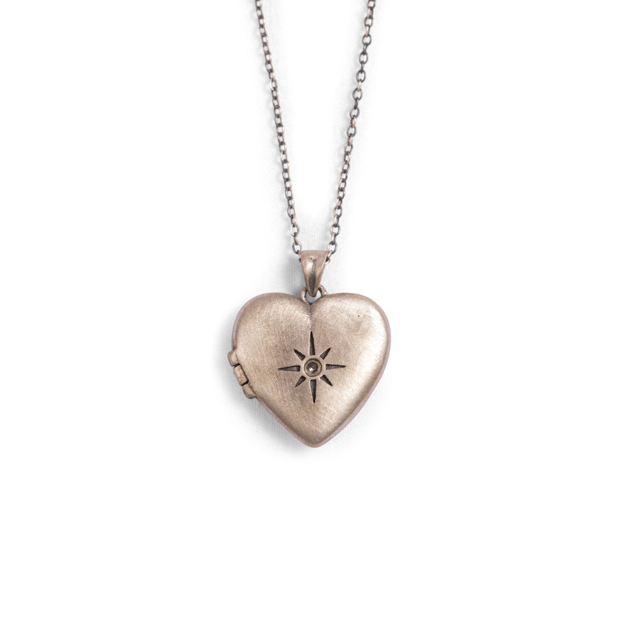 Heart shaped locket with stone