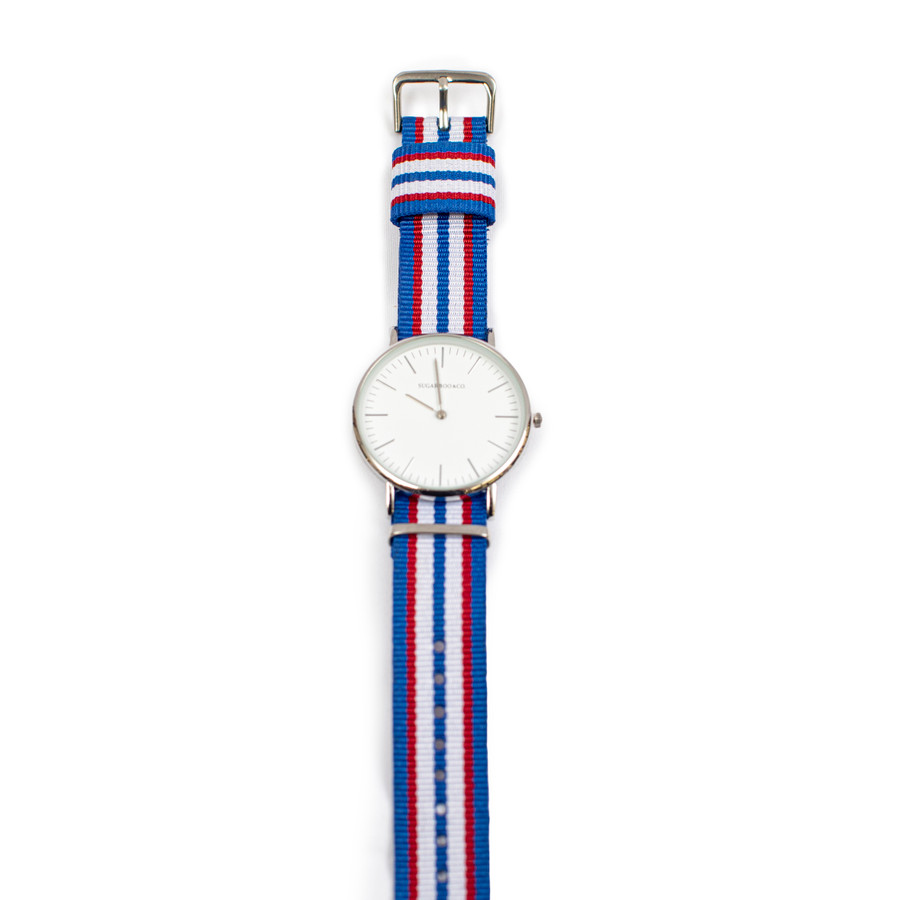 wrist watch with red, white, and blue striped nylon strap