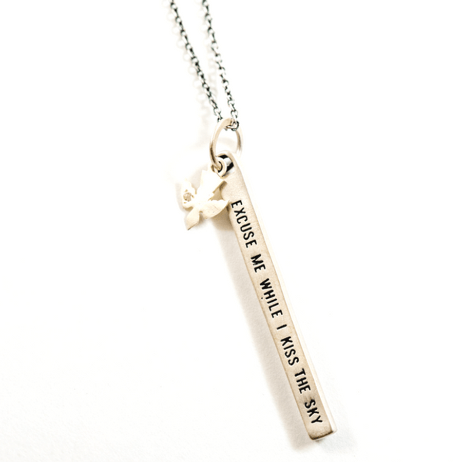 "sterling silver necklace with the quote ""excuse me while i kiss the sky"""