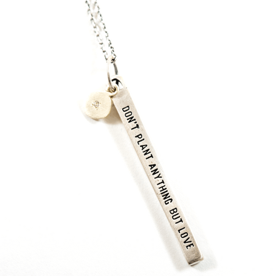 "sterling silver necklace with the quote ""don't plant anything but love"""