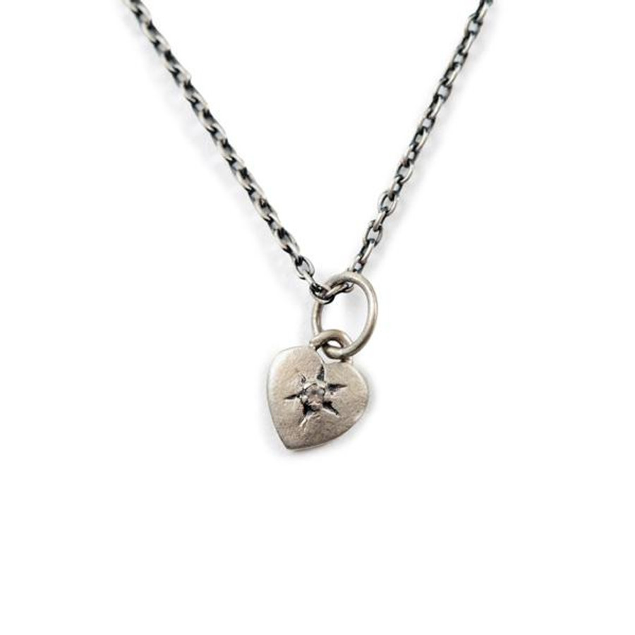 sterling silver necklace with heart shaped white topaz stone