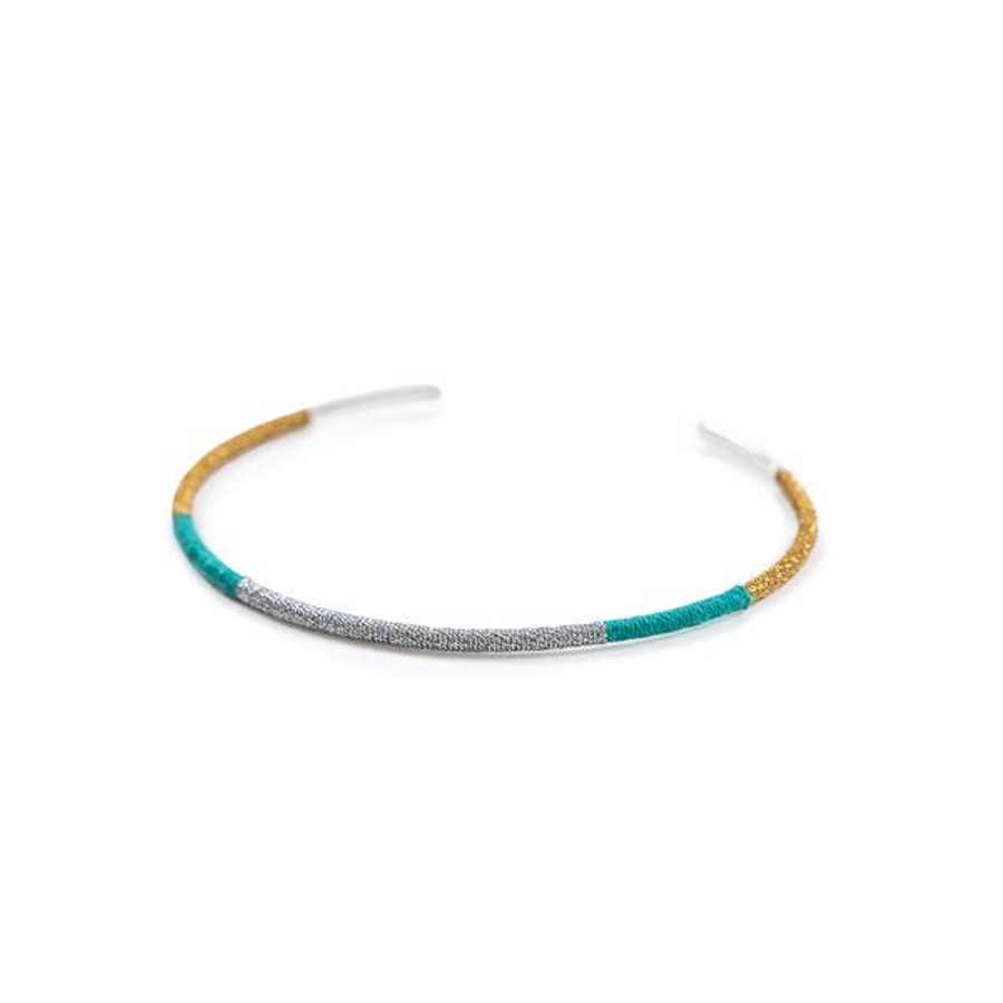silver cuff bracelet with a (gold-turquoise-gret-turquoise-gold) wrapped thread
