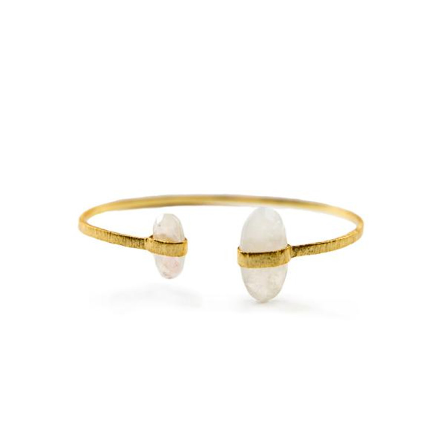 open gold bangle with small and large moonstones