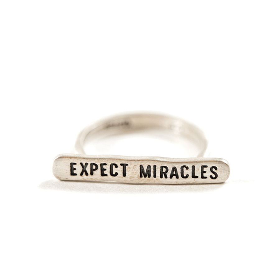 "sterling silver ring with bar with ""expect miracles"" engraved"