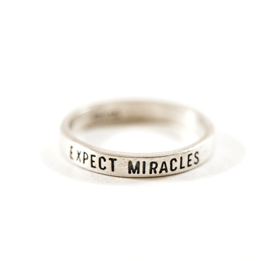 "sterling silver ring with ""expect miracles"" engraved"