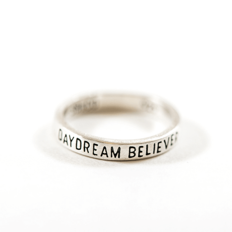 """sterling silver ring with """"daydream believer"""" engraved"""