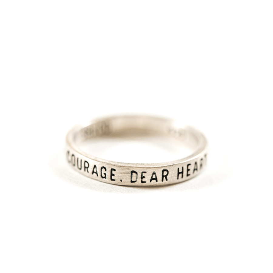 "silver ring with ""courage dear heart"" engraved"