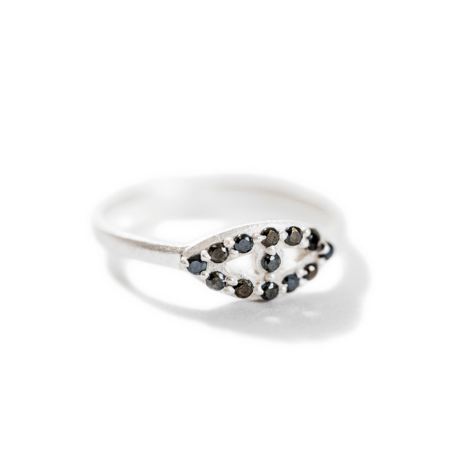 silver ring with black zircon stones in the shape of an eye