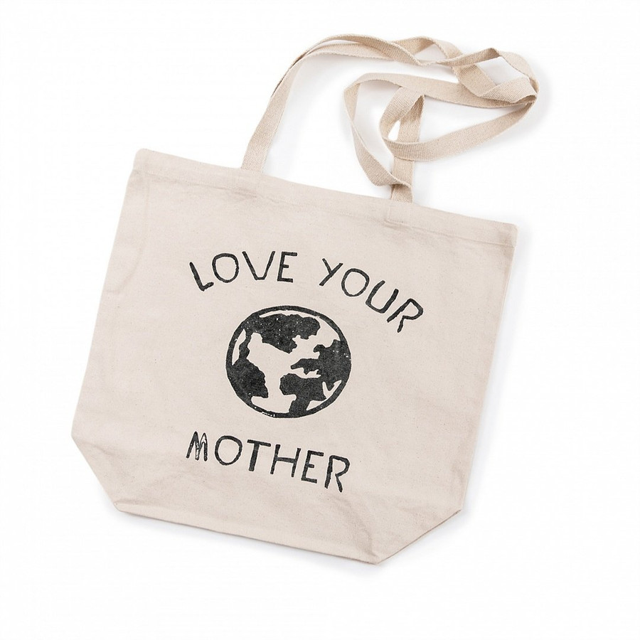 """canvas tote bag with long handles, outline of a globe, and the quote """"love your mother"""""""