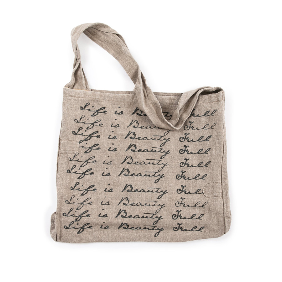"""canvas messenger bag with """"life is beauty full"""" written in black script font"""