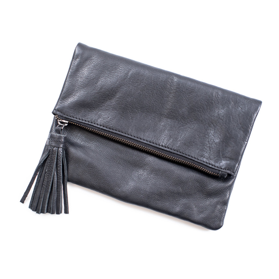black leather clutch with flap closure and zipper with leather tassel