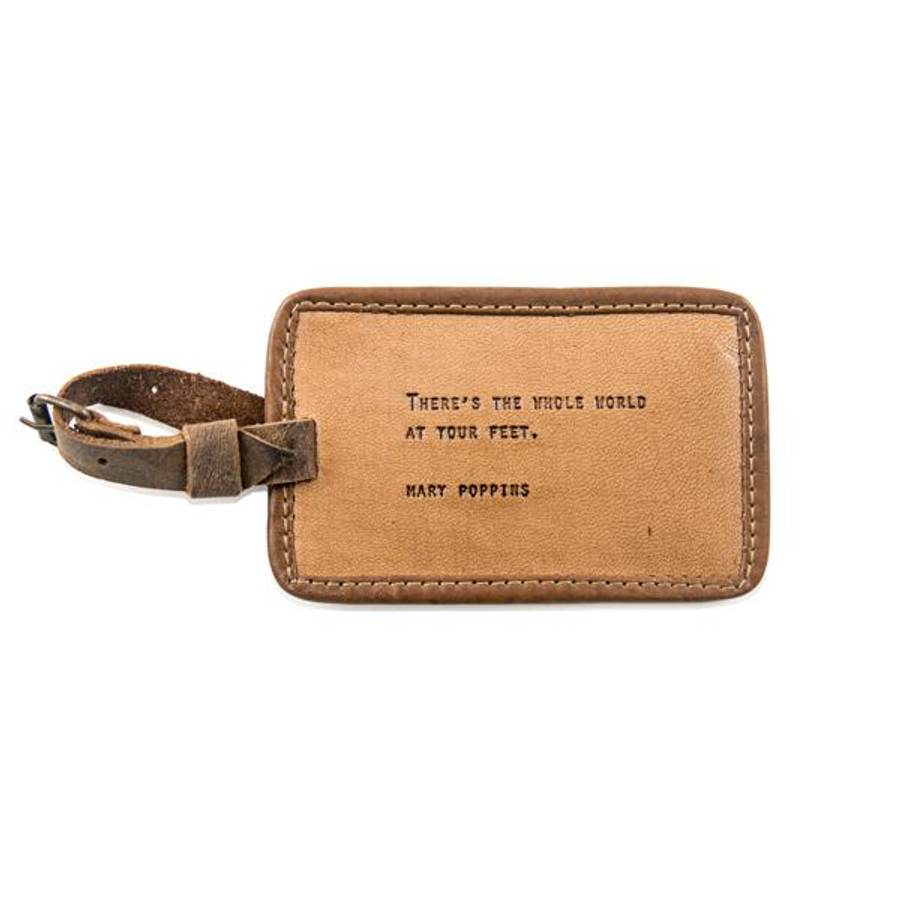 "brown leather luggage tag with the quote ""there's the whole world at your feet"""