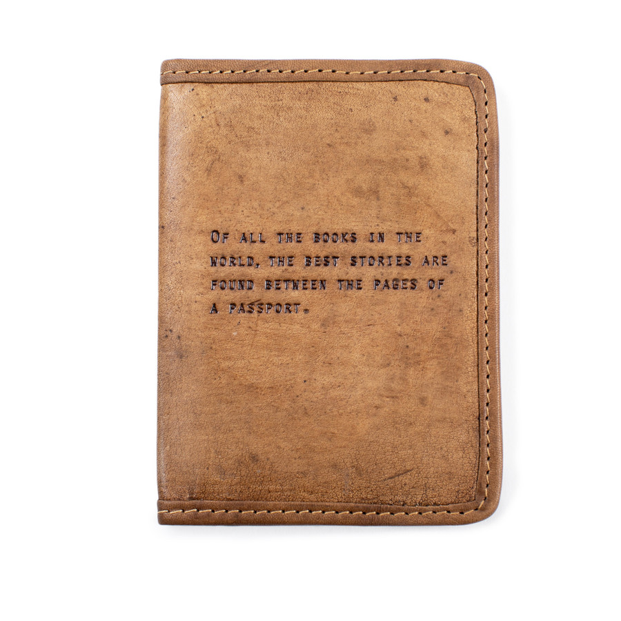 "brown leather passport cover with the quote ""of all the books in the world..."" (entire quote in description)"