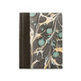 A journal with a green marble design and dark brown binding.