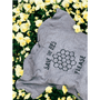 the save the bees please shirt laying on top of yellow and green flowers