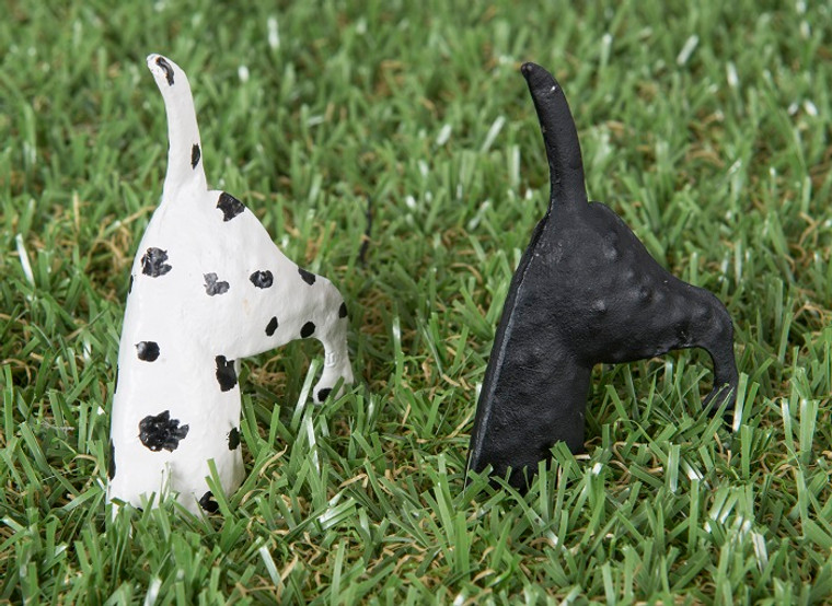 Dogs with head in ground
