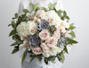 The most luxurious bouquet in soft blush tones of ivory, pink and grey. Abundant with the most beautiful hydrangeas, roses, spray roses, orchids and succulent plants, this bouquet is the perfect mix of understated elegance.