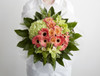 Zesty, fruity lime green orchids are paired with fresh jade green hydrangeas, mixed with coral roses and germini. This bouquet is perfect to brighten up someones day.