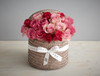 Perfect for any season is this gorgeous natural hatbox, filled with the most wonderful shades of pink roses. The contrast between the understated natural toned hatbox against the mixture of soft and hot pink roses makes this a unique gift.