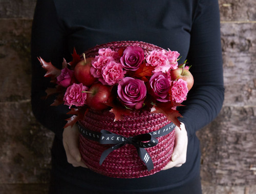 We've hand-picked our very berry toned roses and gathered them into this stunning ruby red Hatbox to create this indulgently rich design - completed with a scattering of miniature apples for a truly Autumnal feel.   Like all of our Hatboxes, 'Blushing Brambles' is expertly made by one of our talented florists using the highest quality flowers, beautifully gift wrapped and finished with a hand written card.