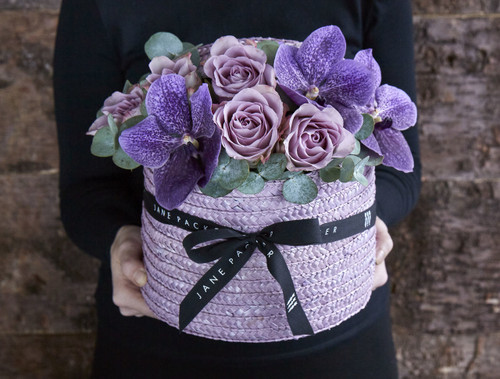 Stay 'Ever Elderberry' with this stunning kaleidoscope of purples from the deep 'Tweed Blue' vanda orchids to vintage toned 'Memory Lane' roses, stylishly put together in our lavender Hatbox.  Like all of our Hatboxes, 'Ever Elderberry' is expertly made by one of our talented florists using the highest quality flowers, beautifully gift wrapped and finished with a hand written card.