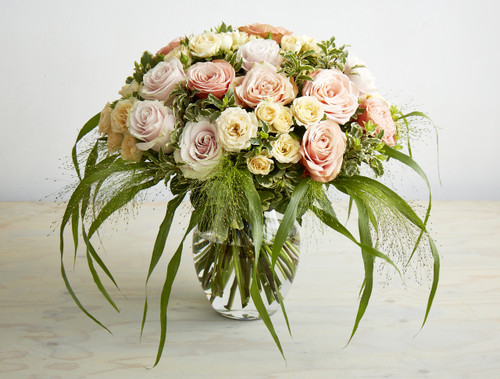 Luxurious 24 rose stemmed bouquet of Kahala, Pink Mondial and Peach Spray rose