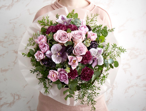 Tulips, Vanda Orchids, Scabiosa, Carnations, Memory Lane Roses, Asparagus Cewebe, Eucalyptus.