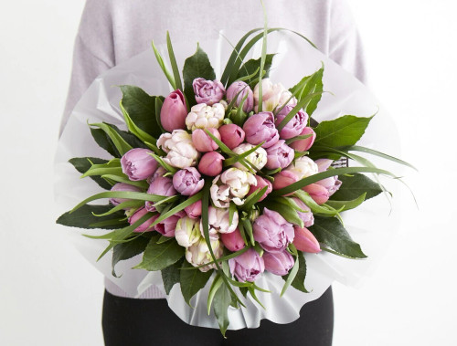 A Spring bouquet made up of the most sweetly toned tulips in shades of pink and lilac.