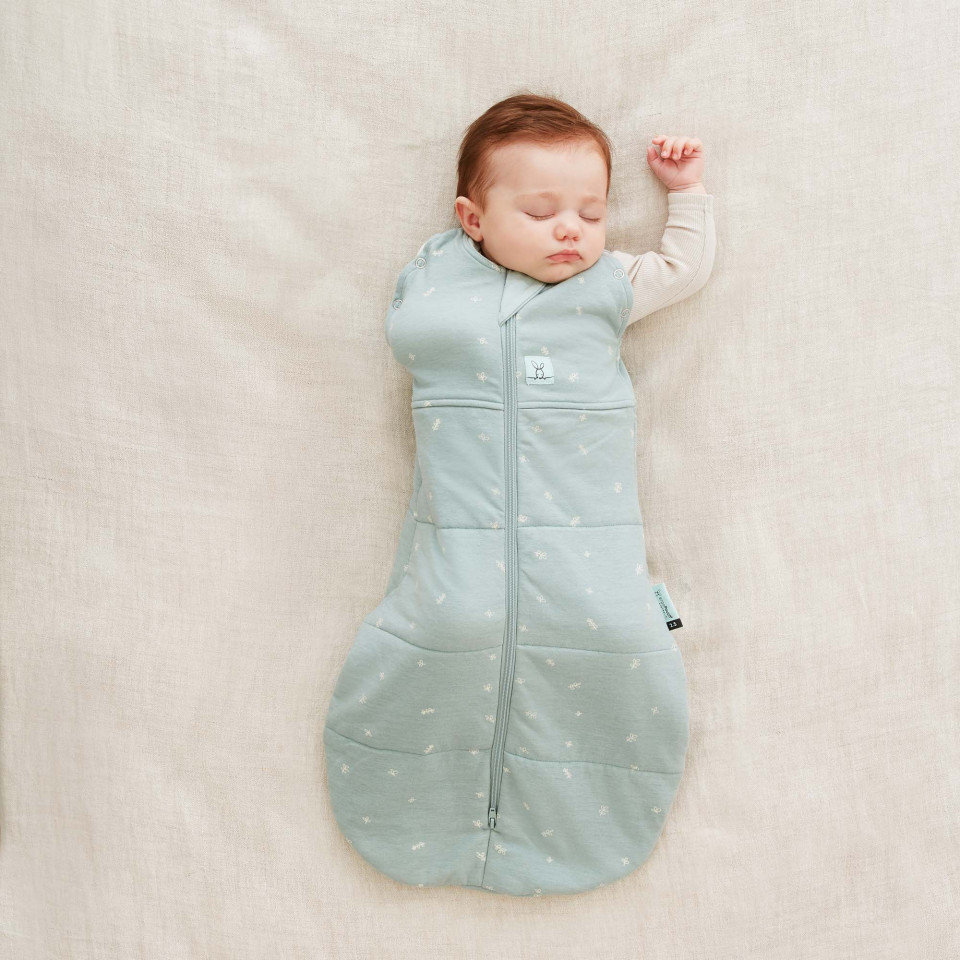 Baby with arm out in Ergopouch 2.5 Tog Cocoon Swaddle
