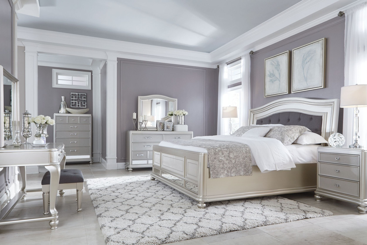 Coralayne Silver 11 Pc Dresser Mirror Chest King Upholstered Panel Bed 2 Nightstands Vanity With Mirror Stool On Sale At Montana S Home Furniture Serving Houston Tx