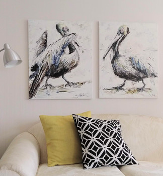 Pelicans over a sofa.