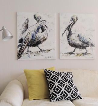 Pelicans over a sofa.