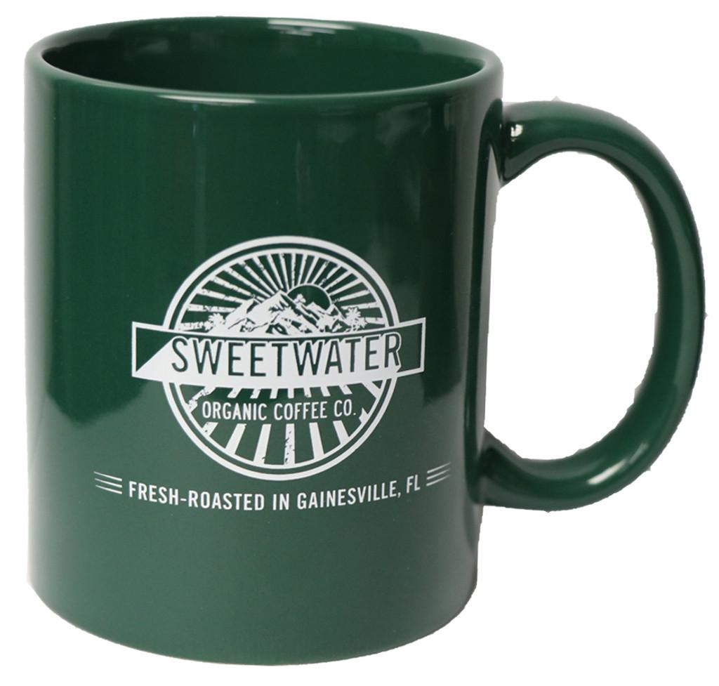 Green ceramic mug with Sweetwater Organic Coffee logo and tagline.