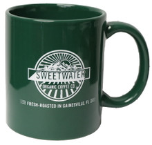 Green ceramic mug with Sweetwater Organic Coffee logo and tagline.