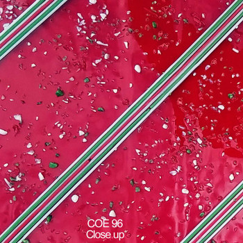 Close up of COE96 Christmas Red Transparent Streamer Custom Sheet by Coloritz